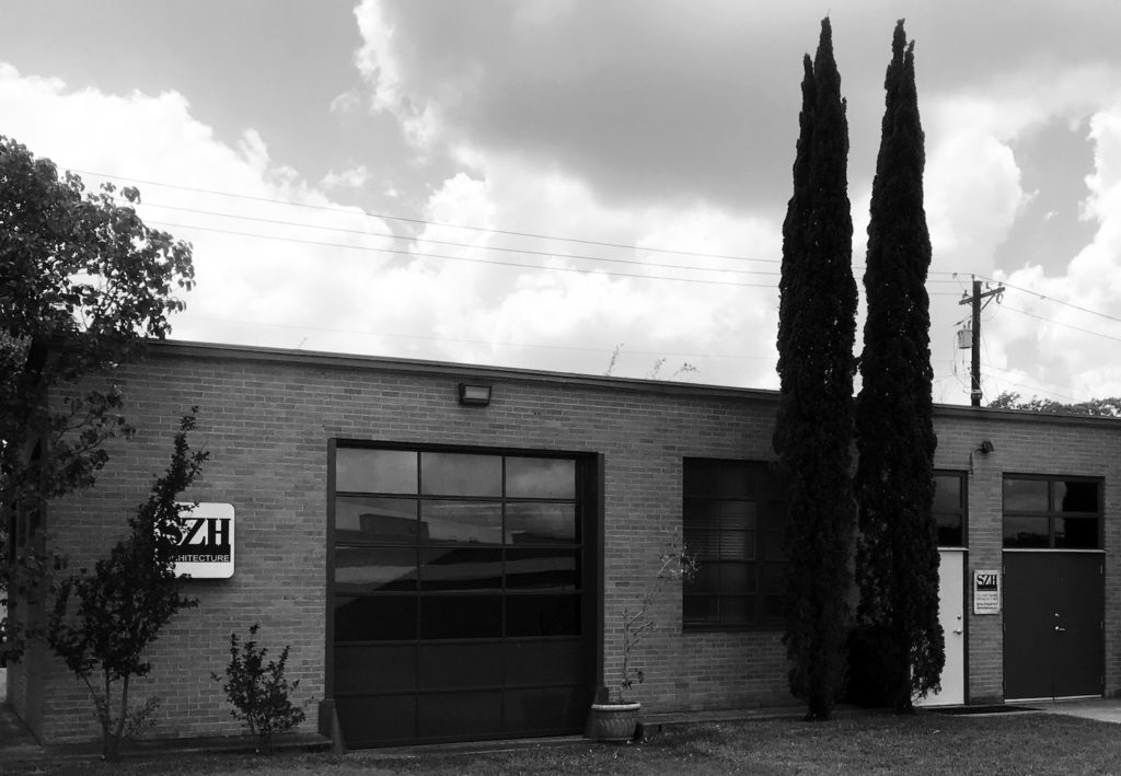 A wide angle view of the SZH office building in black and white.